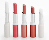 Five Color lipsticks arranged in line on white Royalty Free Stock Photos