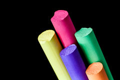 Five colore chalks on a black. Background stock photo