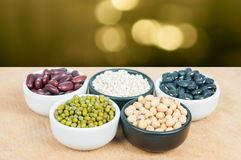 Five colored beans Stock Photo