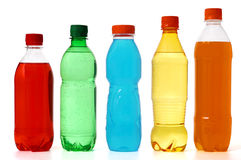 Five colored bottles with juice and soda stock image