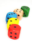 Five colored dice Stock Images