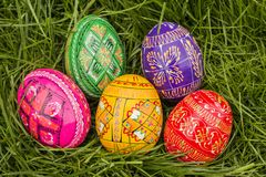 Five Colored Easter Eggs. Some Colored Easter Eggs in Grass Royalty Free Stock Photo