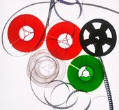Colored 8mm film reels on a white blackground stock images