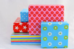 Five colored gifts on white background Stock Images