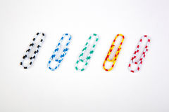Five colored paper clips Royalty Free Stock Image