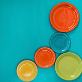 Five colored plates. On a turquoise background. Top view. Flat lay photo Royalty Free Stock Photography