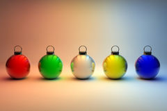 Five colorful Christmas baubles Stock Images