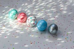 Five colorful eggs lie on a spotted background. Easter, creative coloring eggs independently at home for decoration stock photo
