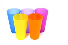 Five colorful glasses. Five brightly colored beverage glasses Stock Images