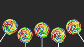 Five colorful lollipops on grey background copy space. Five colorful lollipops on sticks on grey background with copy space Stock Photo