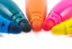 Five colorful pens on a white background - yellow, pink, orange, green and blue Royalty Free Stock Photography