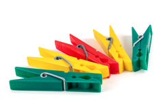 Five colorful plastic clothespins Royalty Free Stock Image