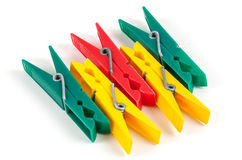 Five colorful plastic clothespins Stock Photography