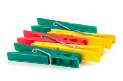 Five colorful plastic clothespins Royalty Free Stock Images