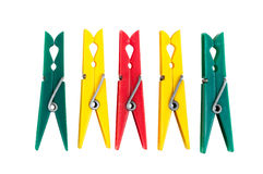 Five colorful plastic clothespins Royalty Free Stock Photos