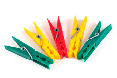 Five colorful plastic clothespins Stock Photos