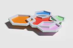 Five colorful three-dimensional hexagons from above Stock Photos