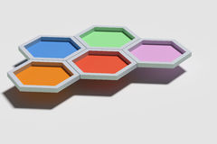 Five colorful three-dimensional hexagons Royalty Free Stock Photography