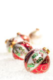Five colourful Christmas  baubles close up Stock Photos