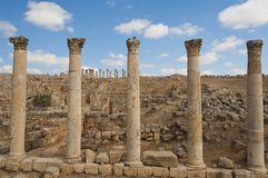 Five columns along the Roman road in Jerash Royalty Free Stock Photo