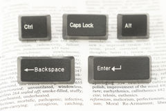 Five Computer Keys on a Book Page Royalty Free Stock Photo