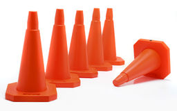 Five cones aligned, one fall down. Over a white background Stock Photo