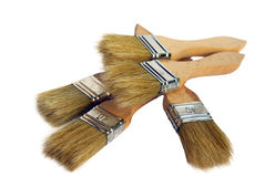 Five construction brushes for painting on the heap isolated Royalty Free Stock Images