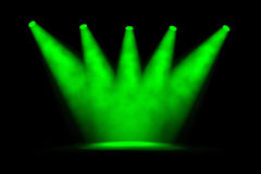 Five Converging Green Spotlight Beams Royalty Free Stock Photography