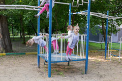 Five copies of cute little girl on playground Royalty Free Stock Images