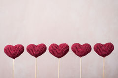 Five crocheted hearts on wooden sticks Royalty Free Stock Photos