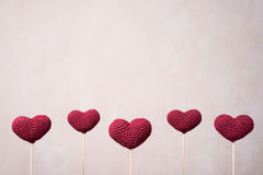 Five crocheted hearts on wooden sticks Stock Photography