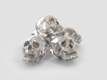 Five crystal skulls. Five human skulls arranged in a pyramid shape, made of a white quartz crystal on a background gray Stock Photos