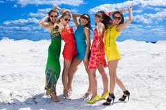 Five Cute girls on the snow ready for party Royalty Free Stock Photography