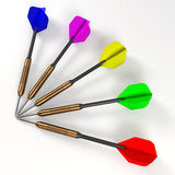 Five darts on white surface Stock Photos