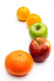 Five-a-day. Five pieces of fruit in a line on a white background Royalty Free Stock Photography