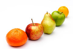 Five-a-day. Five pieces of fruit in a line on a white background Royalty Free Stock Image
