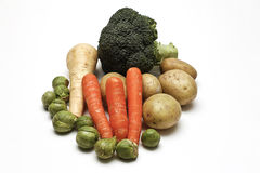 Five a Day. View of five different types of vegetables on a white background Royalty Free Stock Images