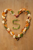 Five A Day! Healthy Heart! Fresh fruit, eating, nutrition, health. Royalty Free Stock Photography