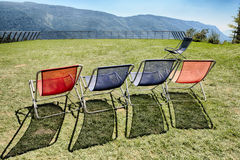 Five deck chairs on the terrace Stock Photos