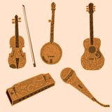 Five decorative musical instruments. Five musical instruments typically associated with country music, a fiddle, banjo, guitar, harmonica and microphone with Royalty Free Stock Photo