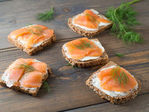 Five delicious sandwiches with smoked salmon Stock Photos