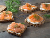 Five delicious sandwiches with smoked salmon Royalty Free Stock Photo
