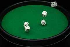 Five dice in motion on green dice board stock images
