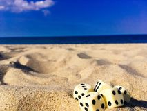 Five Dice on Sand Royalty Free Stock Photos