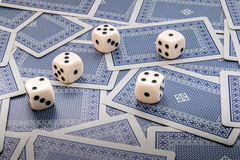 Five Dices and cards. Five Dices and blue facedown cards Stock Images