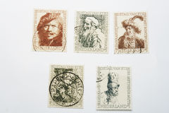 Five different old Rembrandt postage stamps Royalty Free Stock Photo