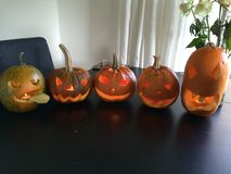 Five different pumpkins with tealights Stock Photo