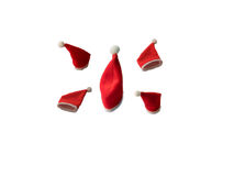 Five different shaped christmas santa hats isolated on a white background Royalty Free Stock Photos
