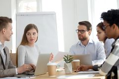 Five diverse multiracial businesspeople working in office room royalty free stock image