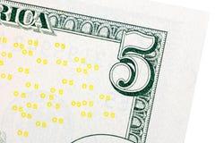 Five dollar bill detail on macro. Stock Photos